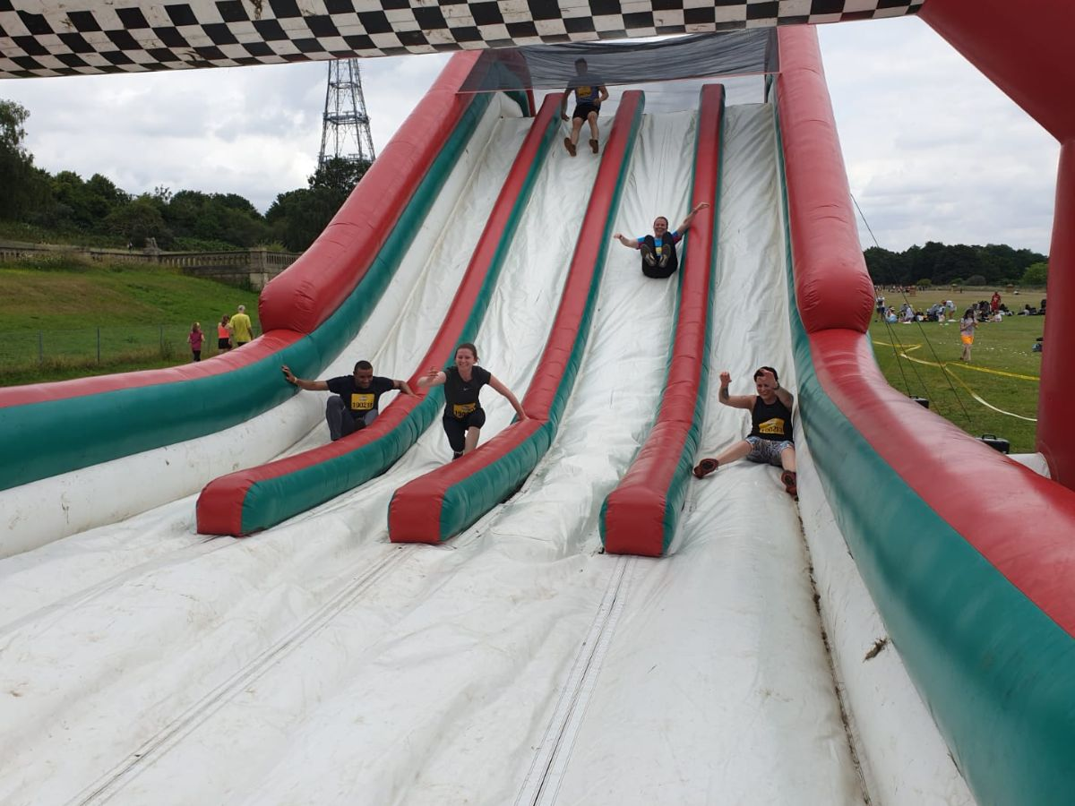 The SARD JV Team on the huge inflatable slide at Gung Ho
